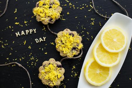 lemon cupcakes on a black background - inscription happy day