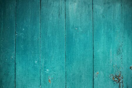 Shabby and very old wooden fence-color aquamarine. Stock Photo