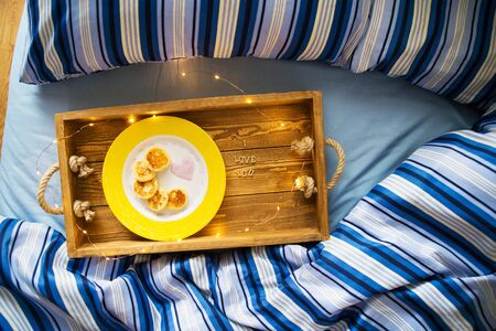cheese pancakes on a tray-breakfast in bed, the inscription I love you-St. Valentines Day. Imagens