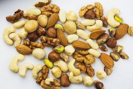 a variety of different kinds of useful nuts on a white background. 版權商用圖片