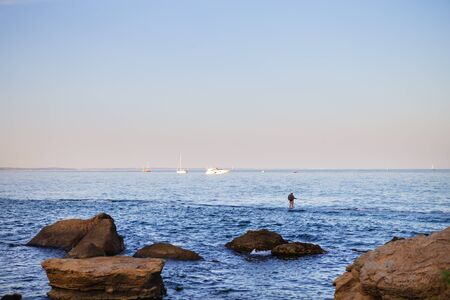 The rocky coast of the Black Sea in the Odessa region in Ukraine, view of the yachts