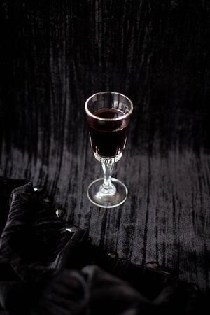 nice glass of red wine on a black background Velvet.