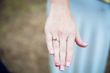 Bride shows a wedding ring on his finger