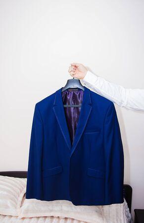blue jacket groom hanging on a hanger