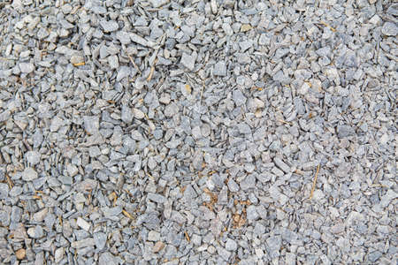 Crushed stone background, gray stone texture Stock Photo