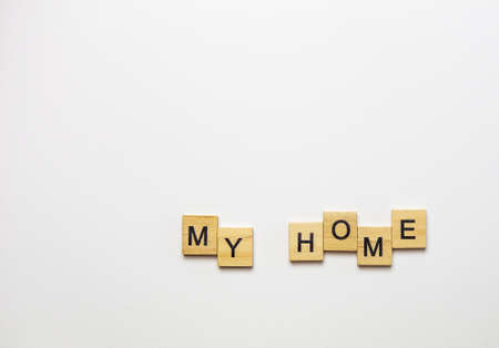 Text my home lined with wooden cubes on white background
