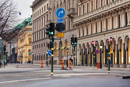 Traffic light and traffic signs on architecture background