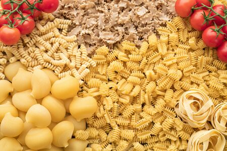 Dry raw scattered pasta texture background 写真素材