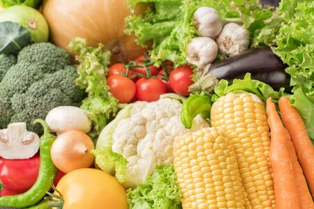 A lot of different raw vegetables in a heap for background