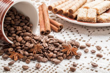 Roasted selective coffee beans on a tablecloth for background