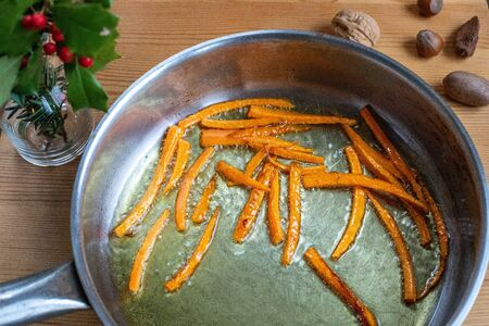 Striped carrots that are fried in a pan for cooking Archivio Fotografico
