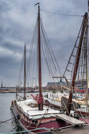 Old wooden sailboats and ships on the water in Stockholm