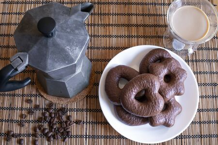 Gingerbread cookies in chocolate with hot coffee