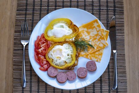 Fried two eggs on a plate for a full breakfast in the morning Archivio Fotografico