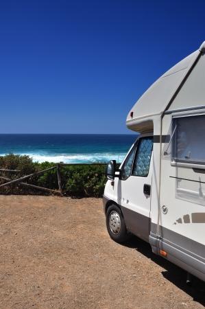Camper van on the beach of Buggerru, Sardinia, Italy