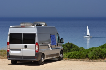 Camper van on the beach of Scivu, Sardinia, Italy photo