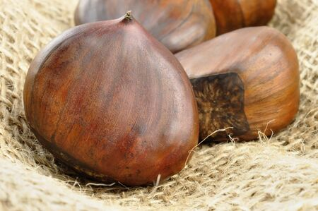 Chestnuts on jute background, selective focus Stock Photo - 16166140