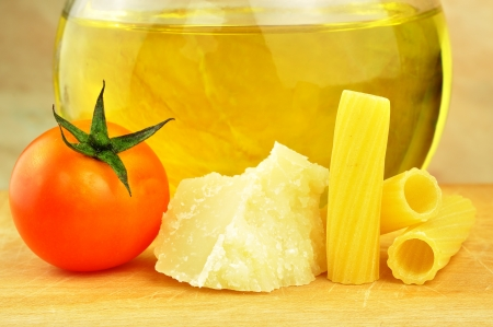 Raw tortiglioni pasta with parmesan, cherry tomato and olive oil Stock Photo - 16166151