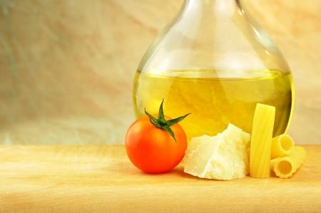 Raw tortiglioni pasta with parmesan, cherry tomato and olive oil Stock Photo - 16166148