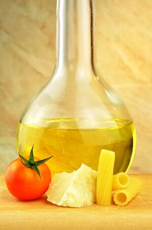 Raw tortiglioni pasta with parmesan, cherry tomato and olive oil Stock Photo - 16166144