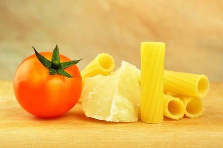Raw tortiglioni pasta with parmesan and cherry tomato, selective focus Stock Photo - 16166152