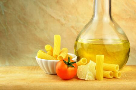 Raw tortiglioni pasta with parmesan, cherry tomato and olive oil Stock Photo - 16166150