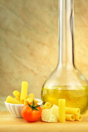 Raw tortiglioni pasta with parmesan, cherry tomato and olive oil Stock Photo - 16166143