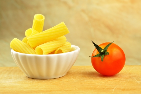 Raw tortiglioni pasta in a small bowl, selective focus Stock Photo - 16166146