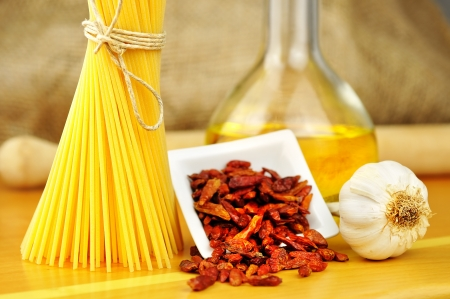 Raw ingredients for spaghetti aglio, olio e peperoncino  garlic, oil, and chili , selective focus Stock Photo - 16462504