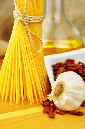 Raw ingredients for spaghetti aglio, olio e peperoncino  garlic, oil, and chili , selective focus Stock Photo - 16462500