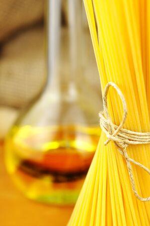 Raw ingredients for spaghetti aglio, olio e peperoncino  garlic, oil, and chili , selective focus Stock Photo - 16462498