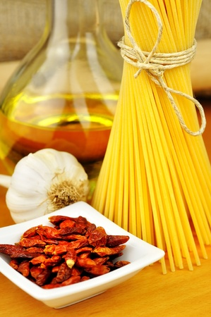 Raw ingredients for spaghetti aglio, olio e peperoncino  garlic, oil, and chili , selective focus Stock Photo - 16462503