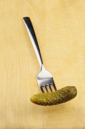 gherkins: Pickled gherkin on a fork Stock Photo
