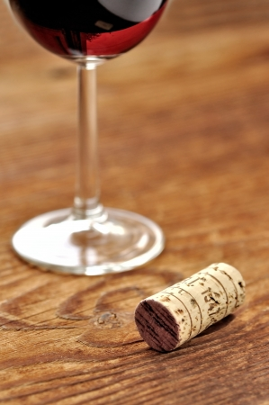 Cork and glass of italian red wine on a table in oak, closeup, selective focus Stock Photo - 16675079