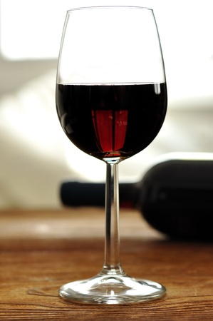 translucent red: Glass of fine italian red wine, selective focus