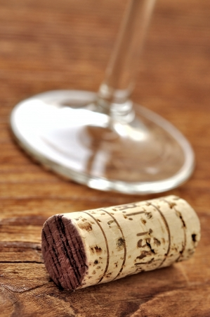 Cork and glass of italian red wine on a table in oak, closeup, selective focus Stock Photo - 16675083