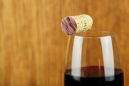 Glass and cork of fine italian red wine, closeup photo