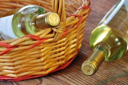 Two bottles of fine italian white wine in a basket photo