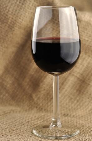 Glass of fine italian red wine, jute background Stock Photo - 16759304