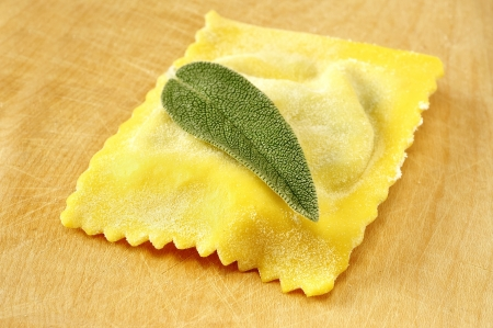 Ravioli, italian egg pasta filled with ricotta and spinach photo