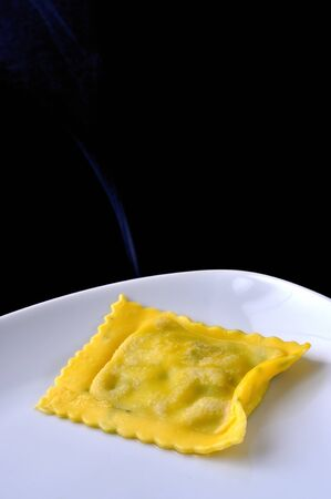 Cooked ravioli, italian egg pasta filled with ricotta and spinach photo