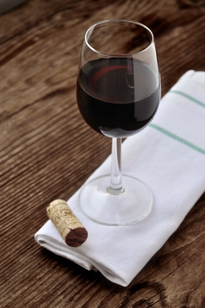 Glass of fine italian red wine on a old wooden table Stock Photo - 16814885
