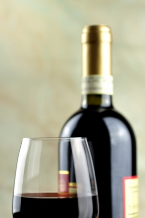 Glass and bottle of fine italian red wine photo