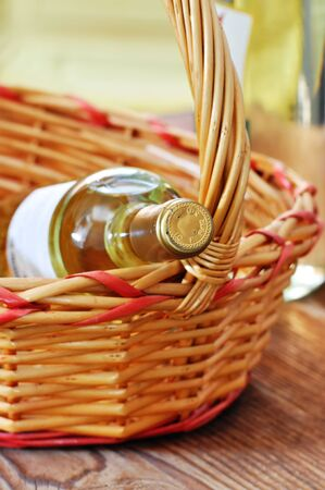 Bottle of fine italian white wine in a basket photo