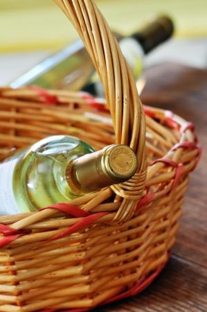 Bottles of fine italian white wine in a basket photo