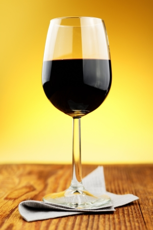 Glass of fine italian red wine on a old wooden table Stock Photo - 16885941