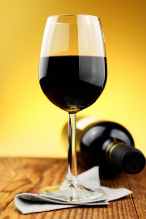 Glass and bottle of fine italian red wine on a old wooden table Stock Photo - 16885950