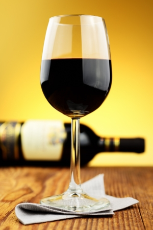 Glass and bottle of fine italian red wine on a old wooden table Stock Photo - 16885930