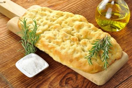 Focaccia s rozmarýnem, olivovým olejem a hrubou solí Reklamní fotografie