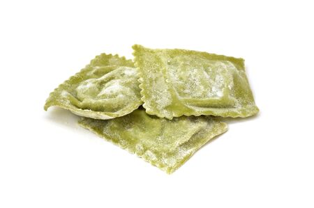 Ravioli filled with ricotta and spinach, fresh homemade italian pasta, isolated on white Stock Photo